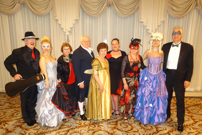 Board Members enjoying February's Masquerade Ball event at Kenwood Country Club